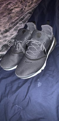 pair of black-and-white running shoes O'Fallon, 63366