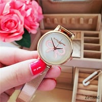 round silver-colored analog watch with pink leather strap College Park, 20740