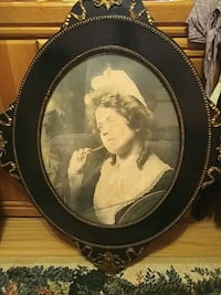 round black wooden framed painting of woman 3125 km