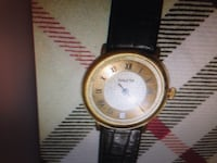 round gold frame analog watch with black leather loop