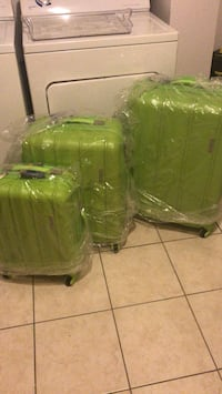 two green plastic armchairs with brown wooden base Montréal, H2A 2P1