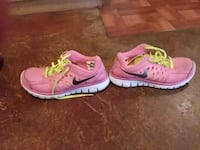 Pair of pink-and-black nike running shoes