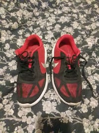 pair of red-and-black Nike running shoes Huntsville, 35816
