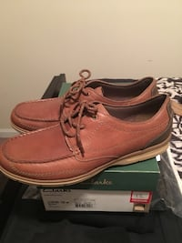 A pair of brown Clark's leather shoes with box size 12 brand new never worn