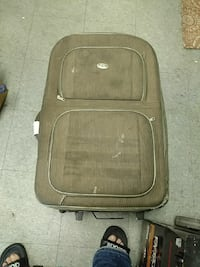 brown and black luggage bag