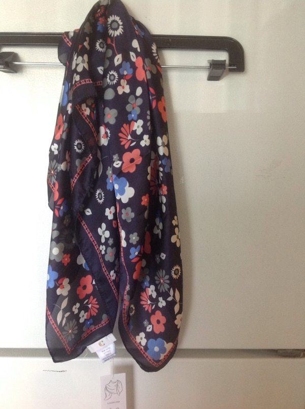 black, red, and white floral scarf