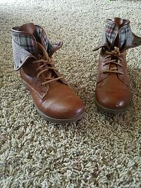 pair of brown leather round-toe boots