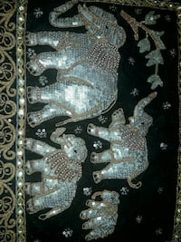 black and gold-colored elephant family painting