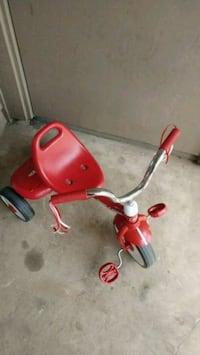 toddler's red and white Radio Flyers pedal trike