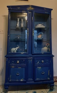 Nice lighted hutch in navy and gold