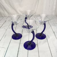 This is a beautiful set of 4 martini glasses with curved
