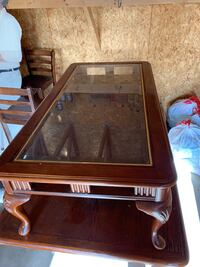 Brown wooden framed glass top coffee table Omaha, 68127