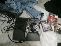 black Sony PS3 super slim console with controllers and game 65 km