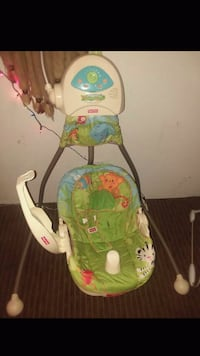 baby's green and white Fisher-Price bouncer Tacoma