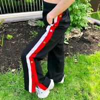 blank pants with red & white sided stripes with bu Montreal