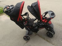 baby's black and red tandem stroller Calgary, T2A 3M8