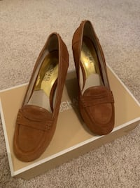 Pair of brown leather slip on shoes