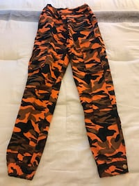 black, red, and green camouflage pants Rockville, 20850