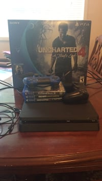 Black sony ps4 console with controller and game cases Alexandria, 22304