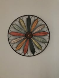 Black and brown floral wall decor made of metal, it's a about 2x2x2 Central Islip, 11722