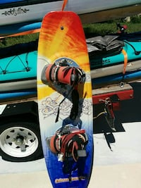 orange, white, red, and blue wakeboard with bindings