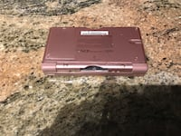 Pink nintendo ds lite with DS backpack