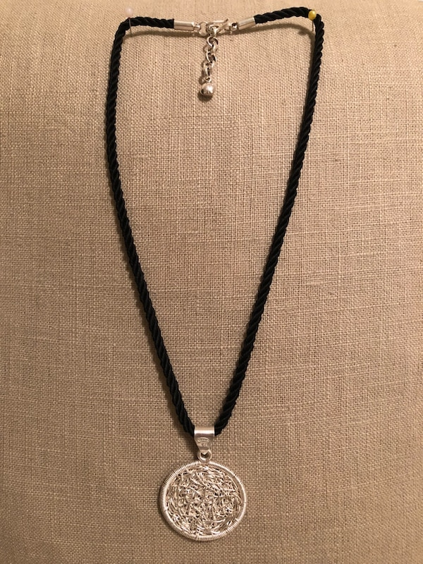 Sterling Silver Medal and black silky cord
