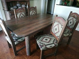 Hand crafted pine dining table & 6 padded chairs