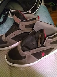 pair of gray-and-black Air Jordan shoes