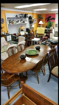 round brown wooden table with four chairs dining set Sanford, 32771
