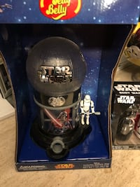 black and gray Star Wars plastic toy with box