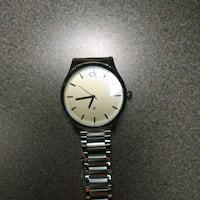 round silver-colored analog watch with link bracelet 3119 km