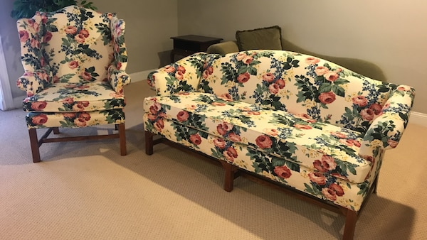 White, red, and green floral pattern couch set