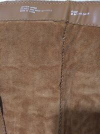 pair of brown leather boots 517 mi