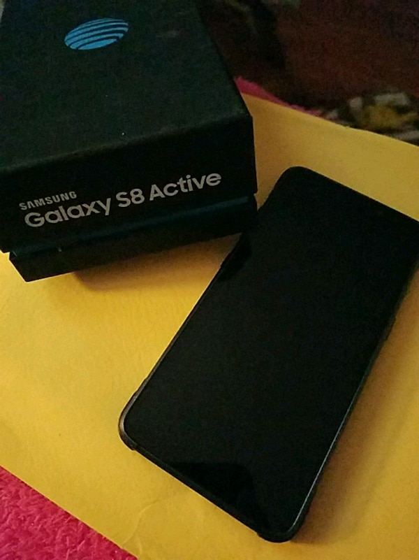 black Samsung Galaxy S8 Active and smart watch