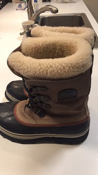 brown-and-black SOrel duck boots 2288 mi