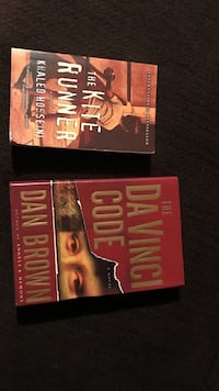 two assorted-title novel books