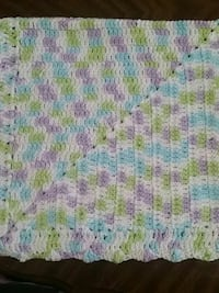 purple, green, and white knitted textile Surrey