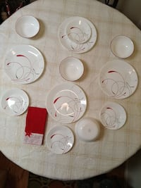 round white-and-red ceramic plates and bowls