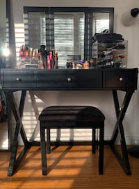 Black mirror vanity with chair