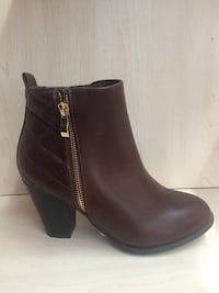 Brand new booties, size 5.5. Laval, H7W 2G4