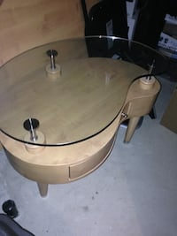 Round clear glass top table wood base