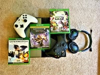 Xbox One console with controller and game cases Olney