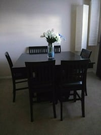rectangular brown wooden table with six chairs dining set Kissimmee, 34741