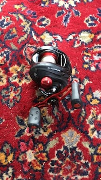 black and red fishing reel