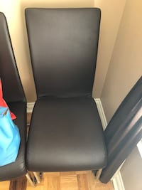 black leather padded rolling armchair Montréal, H1P 2X2