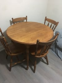 round brown wooden table with four chairs dining set Toronto, M6N 4T2