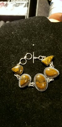 New solid 925 silver tigers eye braclet.