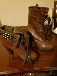 pair of brown leather chunky heeled booties 900 mi
