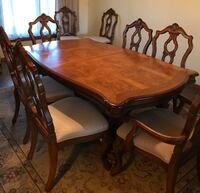Dining table & 8 chairs + 2 leaves.  Sioux Falls, 57105